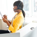 Afro american businesswoman with headset working in call center