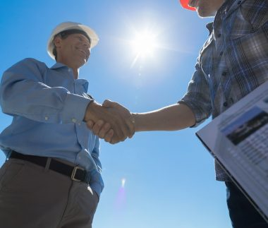 Builders Handshake, Architect And Contractor Agreement During Meeting Discussing Blueprint Buiding